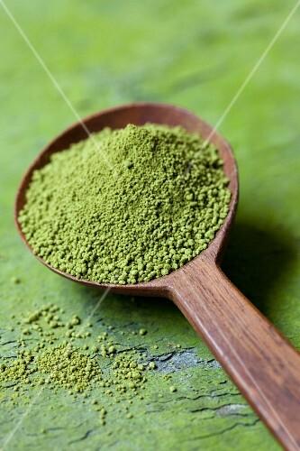 Matcha tea powder on a wooden spoon