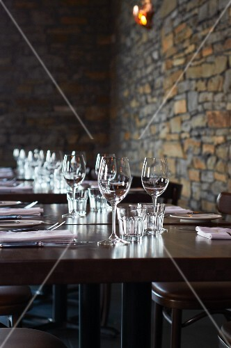 Set tables in rustic restaurant