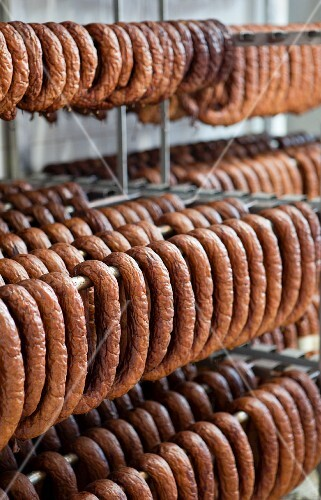 Lots of sausages hanging in a smoke house