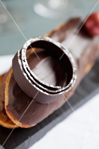 Hand-made chocolate decoration on an éclair
