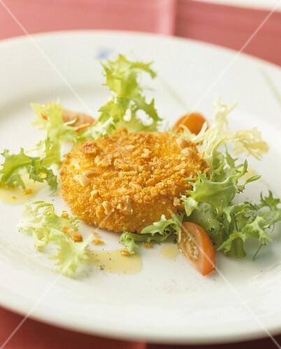 Breaded, baked Camembert with frisée lettuce