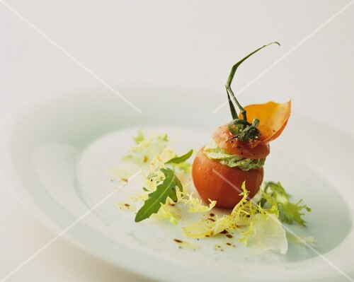 A tomato with a creamy herb filling