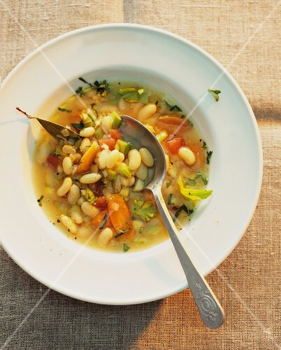 Bean soup with white beans and vegetables (view from above)