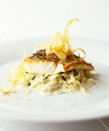 Fish fillet on white cabbage salad