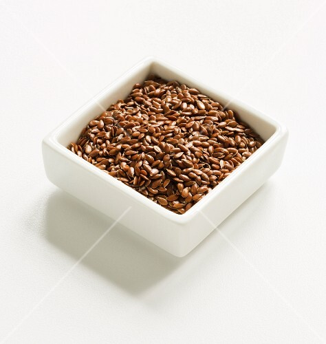 Flax Seeds in a Square White Bowl