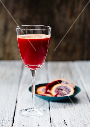 A glass of blood orange & chilli juice