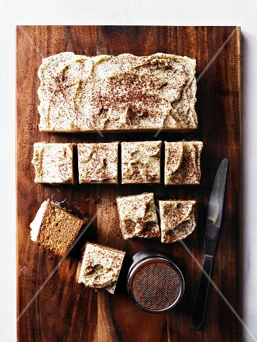 Cappuccino cake being cut into cubes