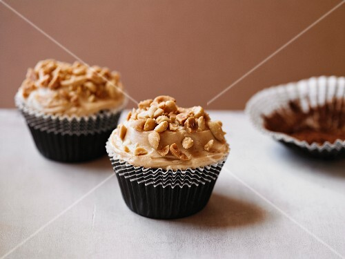 Chocolate & peanut butter cupcakes with chopped peanuts
