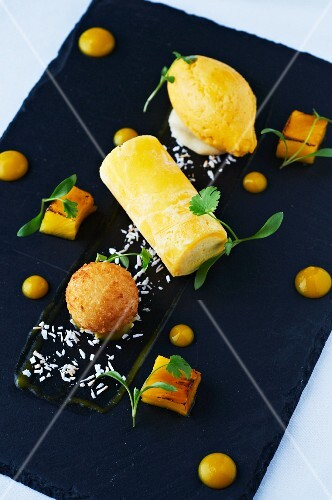 A dessert featuring variations on mango and coconut