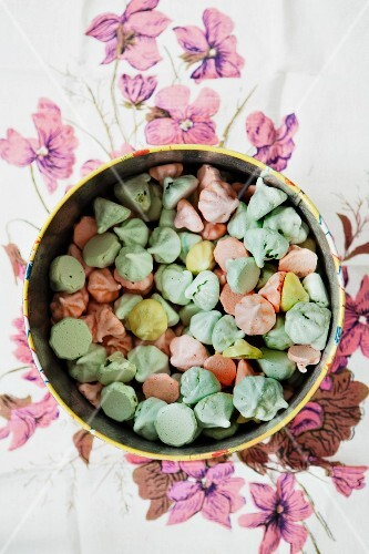 A bowl of pastel coloured meringue dots