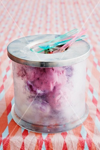 Mixed ice cream in the jar with a lid