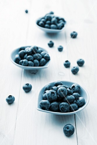 Three small bowls of blueberries