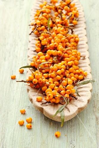 Fresh sea buckthorn berries in an oblong bowl