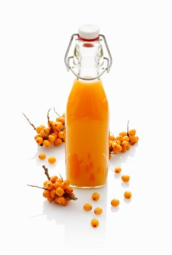 Sea buckthorn juice in a stoppered bottle