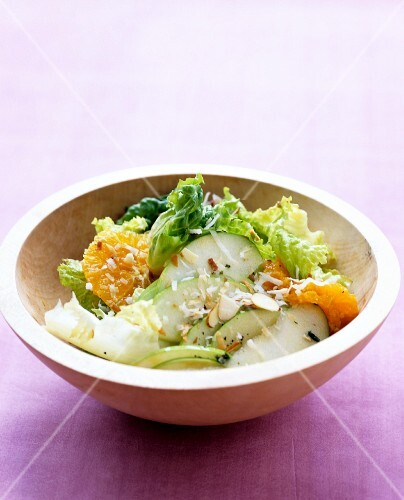 Coconut and tangerine salat with green apples