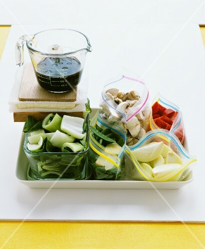 Assorted types of vegetables and mushrooms in freezer bags