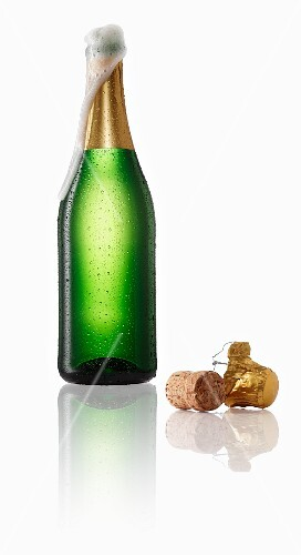 Sparkling wine bubbling out of the bottle