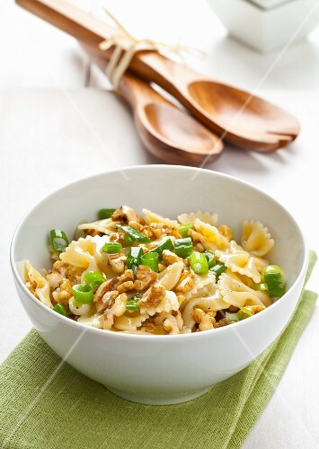 Pasta salad with chopped walnuts and spring onions