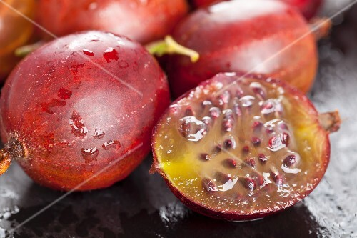 Red gooseberries, whole and halved