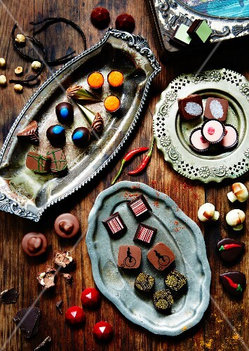 Assorted chocolates on antique trays