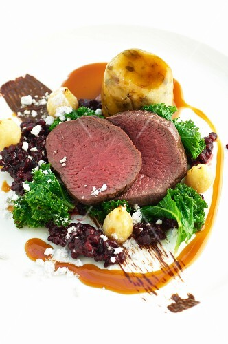 Medallions of venison with kale and cranberries