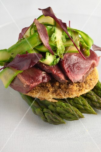 Walnut tart with wild pigeon and asparagus