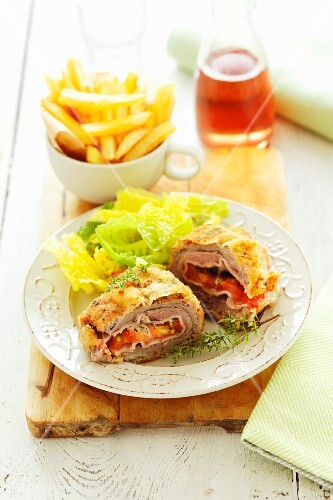 Chicken Cordon Bleu with lettuce and chips