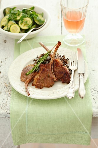 Lamb chops with rosemary, wild rice and a courgette salad