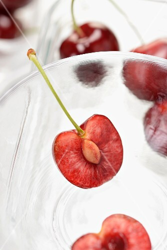 Halved cherries in a glass