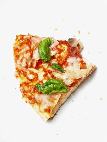 A slice of pizza with mushrooms and basil