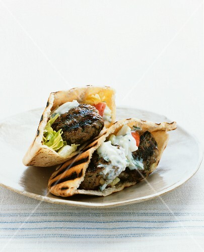 Pita bread filled with meatballs and tzatziki