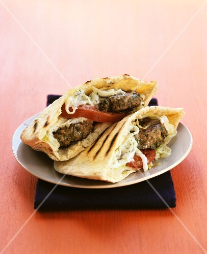 Grilled pita bread filled with mini burgers