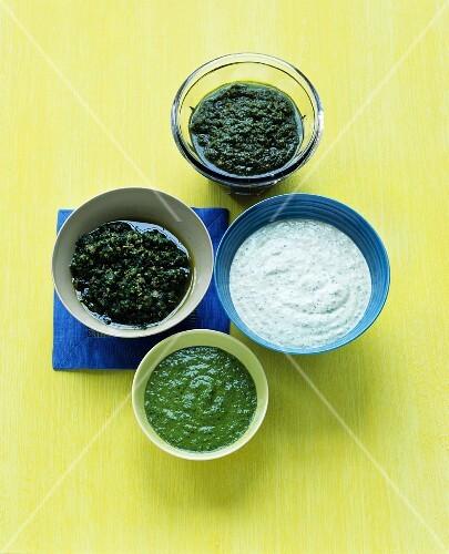 Assorted pestos and a herb & yoghurt sauce