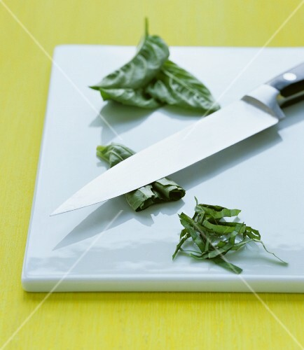 Basil being finely sliced