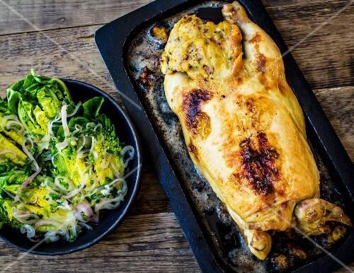 37. Whole roast chicken stuffed with salad