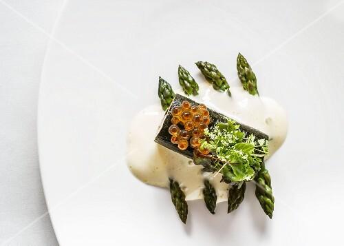 Caviar salmon roulade with asparagus