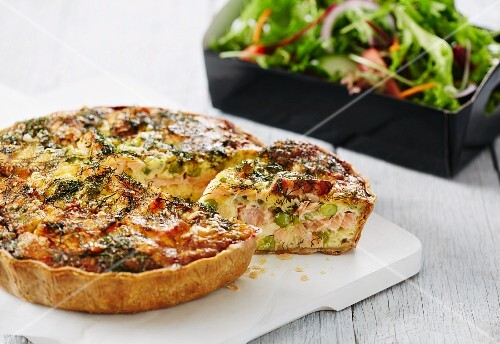 Salmon quiche with dill and peas, with a side of salad