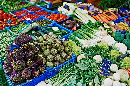 Lots of different types of vegetables in crates at the market