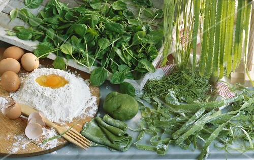 Home-made spinach pasta and ingredients