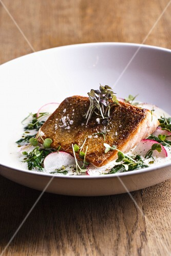Crispy salmon with butter sauce and spinach