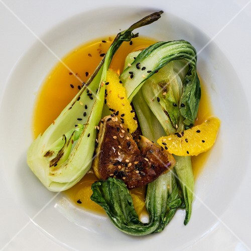Duck liver with orange sauce and pak choi