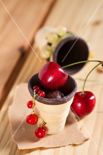 Sweet cherries, redcurrants and red gooseberries in a chocolate wafer cup