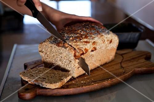 Freshly baked bread being cut