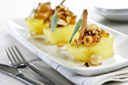 Poached apples with nuts and spices