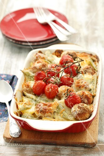 Potato bake with meatballs, tomatoes, beans and cheese