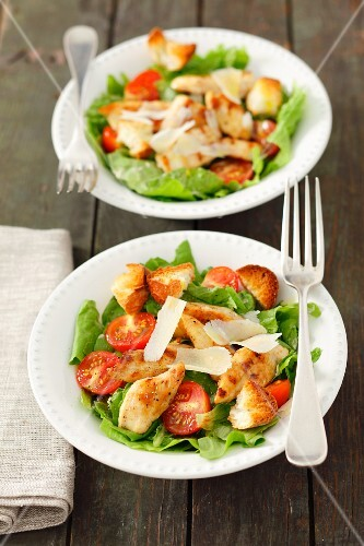 Caesar salad with chicken and tomatoes