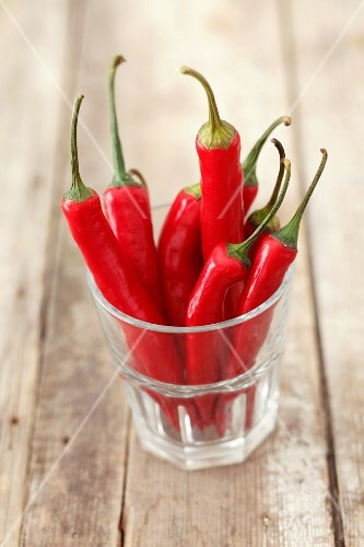 Fresh red chillies in a glass