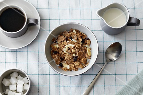 Muesli, milk, coffee and sugar cubes