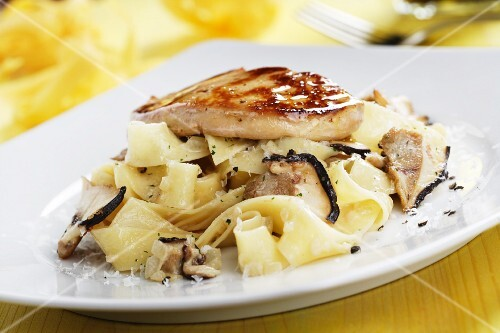 Ribbon pasta with mushrooms and goose liver