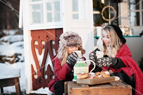 Girls having coffee break in front of gazebo